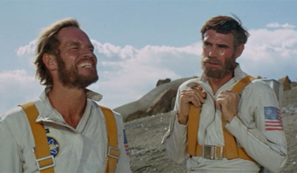 Morale officer Taylor (Charlton Heston)  attempts to cheer up Landon (Robert Gunner)  on THE PLANET OF THE APES.