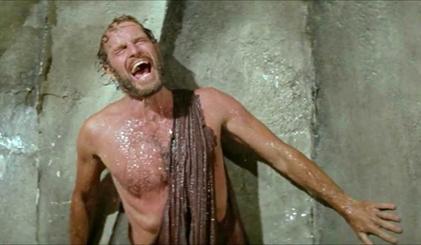 Taylor (Charlton Heston) thinks the ape world is a madhouse in PLANET OF THE APES.