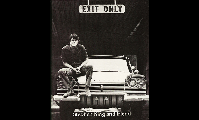 CHRISTINE author Stephen King poses with an automotive accomplice.