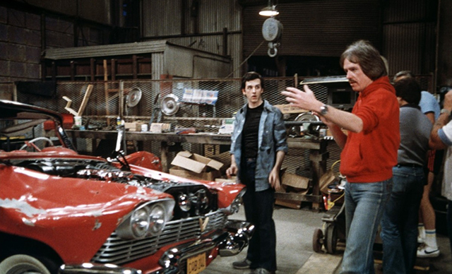 Actor Keith Gordon (left) seeks some direction for his character from director John Carpenter to resurrect the damaged but undying CHRISTINE.