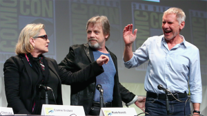 Appearing at the Comic-Con panel for STAR WARS: THE FORCE AWAKENS are (L to R) Carrie Fisher, Mark Hamill and Harrison Ford on July 10, 2015. Photo © Lucasfilm 2015