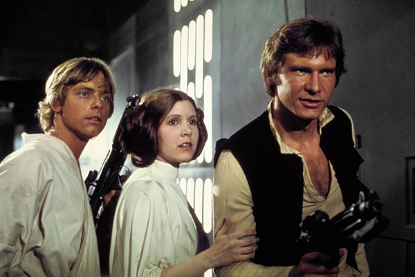 Luke Skywalker (Mark Hamill), Han Solo (Harrison Ford), and Princess Leia (Carrie Fisher) in the Death Star battle station after their escape from the garbage room. © Lucasfilm Ltd. & TM. All Rights Reserved.