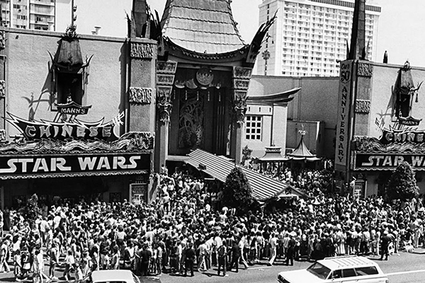 May 1977 and the plaza and street are crammed with STAR WARS fans at the Chinese Theatre in Hollywood, CA.
