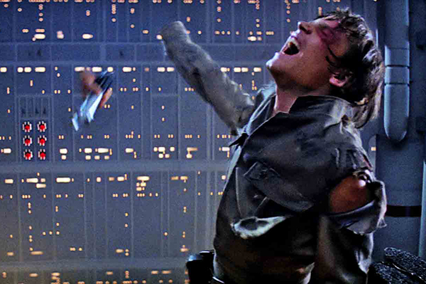 Darth Vader disarms Luke Skywalker in their lightsaber duel on Cloud City in THE EMPIRE STRIKES BACK. Photo: Film Frame..© Lucasfilm