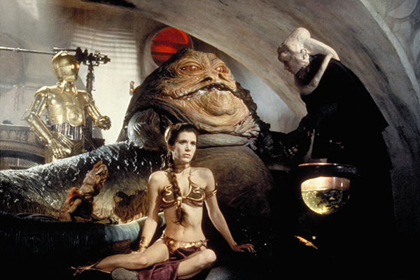 Princess Leia (Carrie Fisher), C-3PO, and Bib Fortuna (Michael Carter) with Jabba the Hutt in his palace on Tatooine. © Lucasfilm Ltd. & TM. All Rights Reserved.
