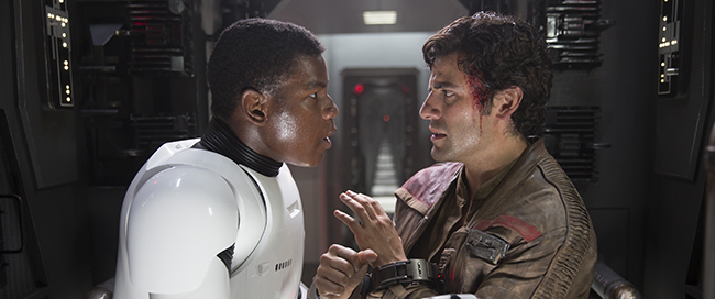 Star Wars: The Force Awakens..L to R: Finn (John Boyega) and Poe Dameron (Oscar Isaac).  Ph: Film Frame. © 2015  Lucasfilm Ltd. & TM. All Right Reserved.