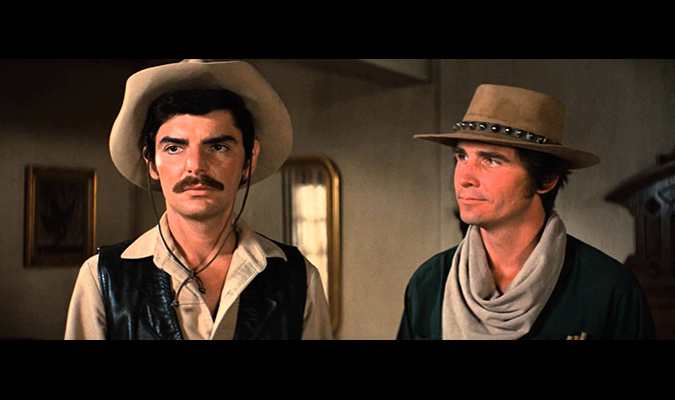 Martin (Richard Benjamin) and Blane (James Brolin) get into their frontier mindset before venturing into WESTWORLD.