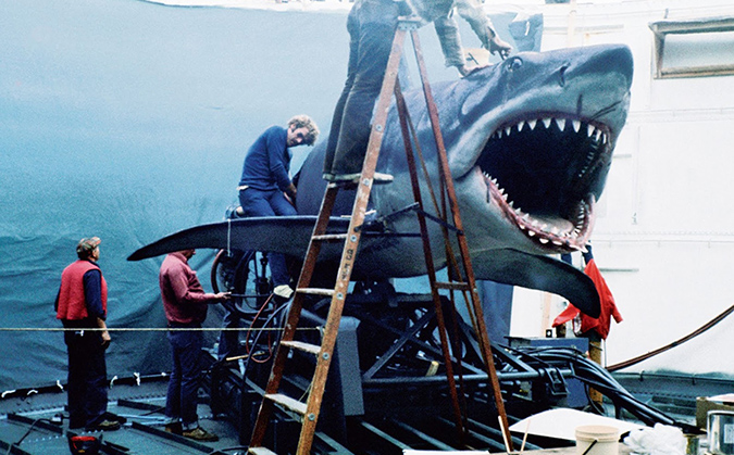 Behind the scenes photo of the crew working on one of the mechanical sharks used in filming JAWS.
