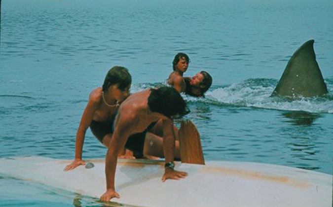 Still image from the infamous deleted scene in JAWS, showing the estuary victim (Ted Grossman) saving MIchael Brody (Chris Rebello) from the shark attack.
