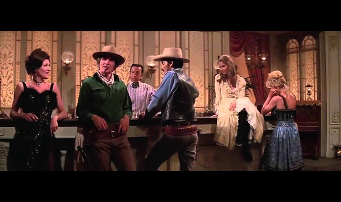(L to R) MIss Carrie (Majel Barrett) welcomes Blane (James Brolin) and Martin (Richard Benjamin) to her brotherl for some adult entertainment in WESTWORLD.