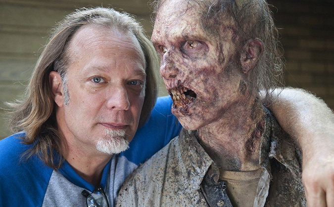 THE WALKING DEAD executive producer/director/effects creator Greg Nicotero poses with one of his character creations from the hit horror series.