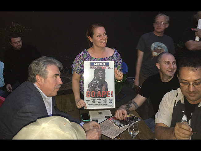Jamie Kristen (center) and Garrett O'Brien (middle right) win a Mego Go Ape poster as the Damn Dirty Geeks and friends celebrate our 2nd annual Planet of the Apes Day.