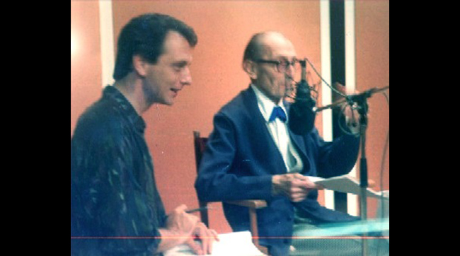 Writer/director Ted Newsom with Peter Cushing in the recording studio for FLESH AND BLOOD: THE HAMMER HERITAGE OF HORROR.