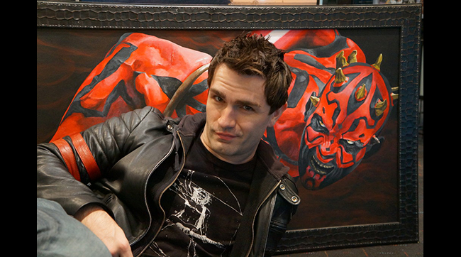 Sam Witwer poses with Darth Maul fan art by Rexor101.