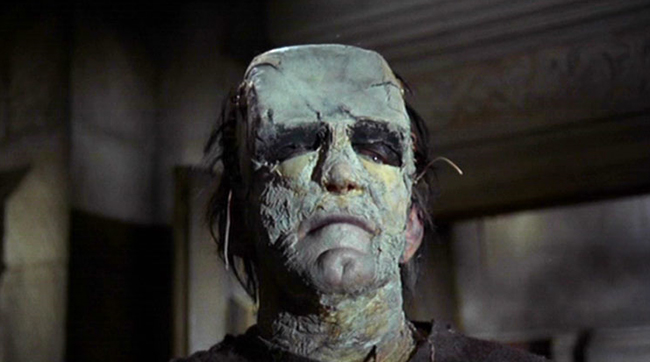 Kiwi Kingston portrays the Creature in Hammer's THE EVIL OF FRANKENSTEIN (1964).