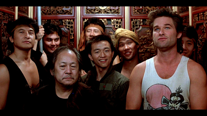 Egg Shen (Victor Wong), Wang Chi (Dennis Dun) and Jack Burton (Kurt Russell) lead Chinatown warriors in an attack on David Lo Pan in John Carpenter's martial arts action-comedy BIG TROUBLE IN LITTLE CHINA.
