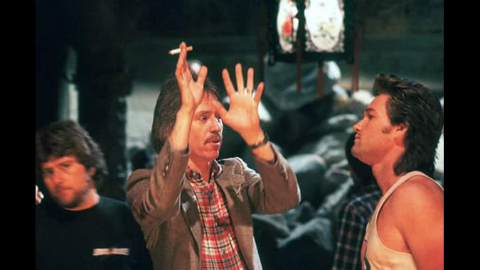 Director  John Carpenter works on scene action with Kurt Russell on the set of the martial arts action-comedy BIG TROUBLE IN LITTLE CHINA.