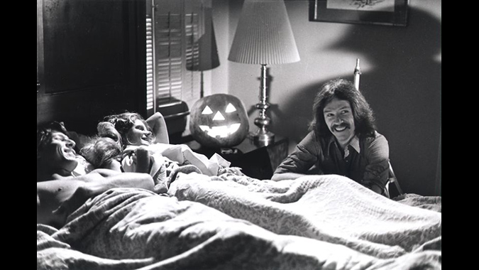 John Carpenter directing Lynda's post-seduction scene with John Michael Graham and P.J. Soles on the set of HALLOWEEN.