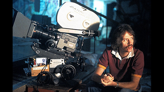 John Carpenter inbetween shots during production of his 1981 action standout film ESCAPE FROM NEW YORK.
