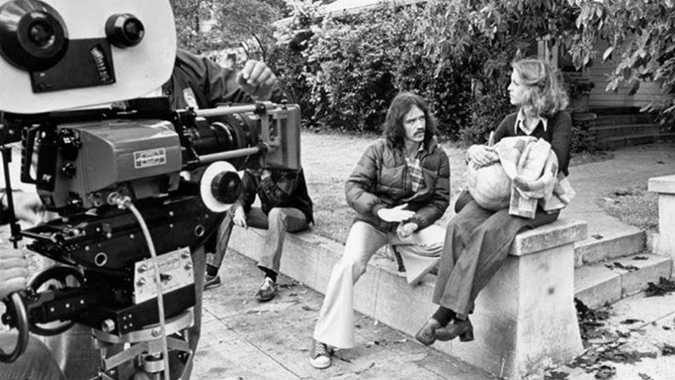 On location in Pasadena filming HALLOWEEN, director John Carpenter discusses a scene with the film's star Jamie Lee Curtis. Photo Credit: Kim Gottlieb-Walker