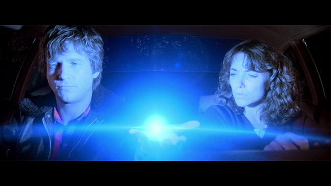 Starman (Jeff Bridges) displays his alien powers to Jenny (Karen Allen) in their quest to return him safely to his home planet before government forces take him captive in John Carpenter's atypical 1984 sci-fi/romance STARMAN.