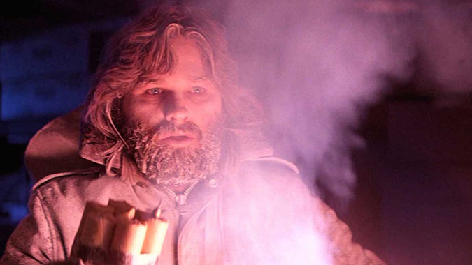 MacReady (Kurt Russell) confronts an alien threat and human paranoia in John Carpenter's influential horror thriller THE THING, a film lost in the 1982 box office wake of Speilberg's E.T. yet now reappraised as an enduring, decade-defining classic film.