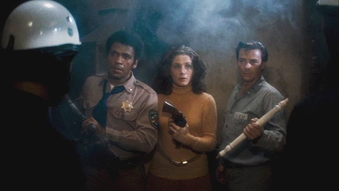 Defending a decommissioned police station, Bishop (Ausatin Stoker), Leigh (Laurie Zimmer) and Wilson (Darwin Joston) survive John Carpenter's ASSAULT ON PRECINCT 13.