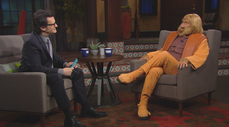 TCM host Ben Mankiewicz interviews comedian Dana Gould as Dr. Zaius in two special video segments produced for the TCM/Fathom Events screening of PLANET OF THE APES.