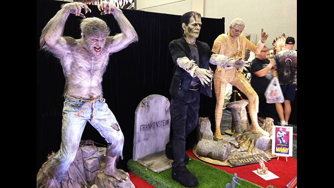 Mike Hill's life-size recreation of the classic Aurora Wolf Man monster model kit next to recreations of the Frankenstein and Mummy kits, debuted at Monsterpalooza 2015.