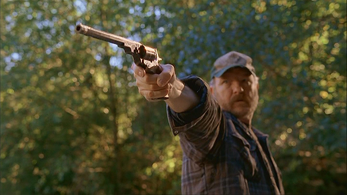 Jim Beaver tests a firearm as Bobby Singer in the popular series SUPERNATURAL.