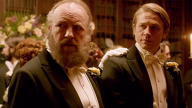 Carter Cushing (Jim Beaver) and Dr. Alan McMichael (Charlie Hunnam) are surrounded by unsettling mysteries in Guillermo del Toro's gothic romance drama CRIMSON PEAK.