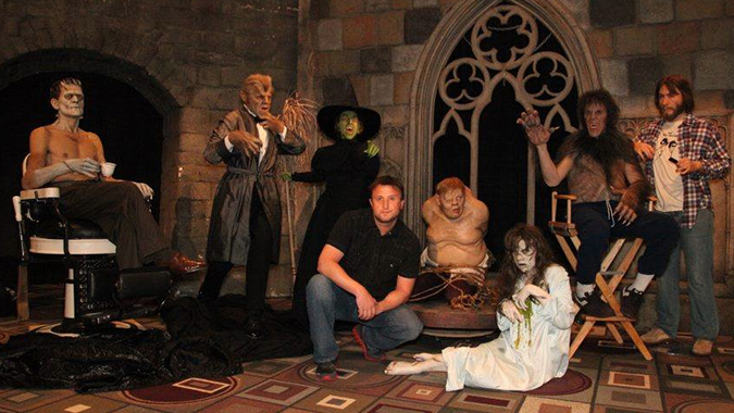 Mike Hill (center) posing with his amazing life-size figures: (L to R), Karloff in the makeup chair as the Frankenstein monster, Henry Hull from WEREWOLF OF LONDON, Margaret Hamilton as the Wicked Witch of the West, Charles Laughton as the Hunchback, Linda Blair as Regan, David Naughton in Rick Baker's makeup chair for AN AMERICAN WEREWOLF IN LONDON.