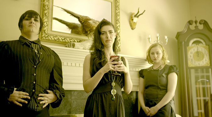 Alice Marsh (Tristan Risk, center) and her followers represent a new horror threat in director Izzy Lee's Lovecraftian short INNSMOUTH.