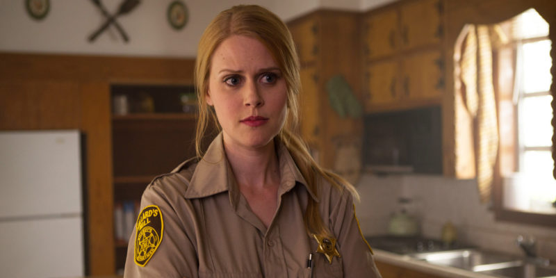 New town sheriff Evie Barret (Janet Varney) must fight the demonic forces of an ancient curse if she is to survive her fight with STAN AGAINST EVIL, Dana Gould's new IFC series premiering November 2, 2016.