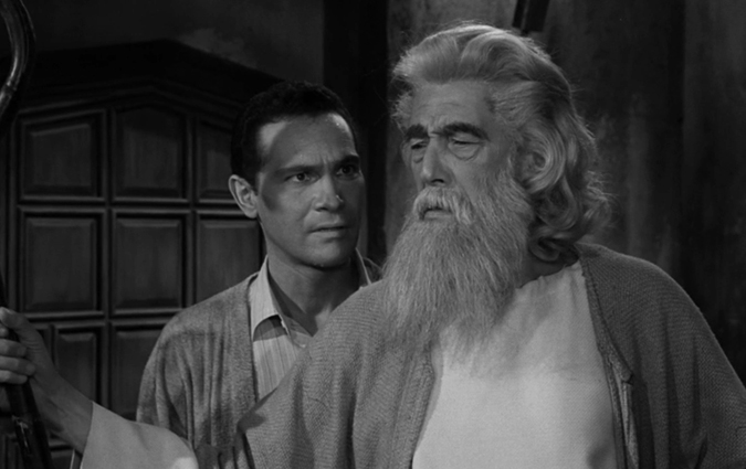 David Ellington (H.M. Wynant) disbelieves the ominous warnings from Brother Jerome (John Carradine) in the classic TWILIGHT ZONE epiosde 'The Howling Man' which originally aired on November 4, 1960.