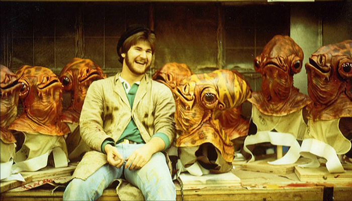 Kirk Thatcher takes a break in the ILM creature shop with a few of his Mon Calamari friends during production of STAR WARS: RETURN OF THE JEDI.