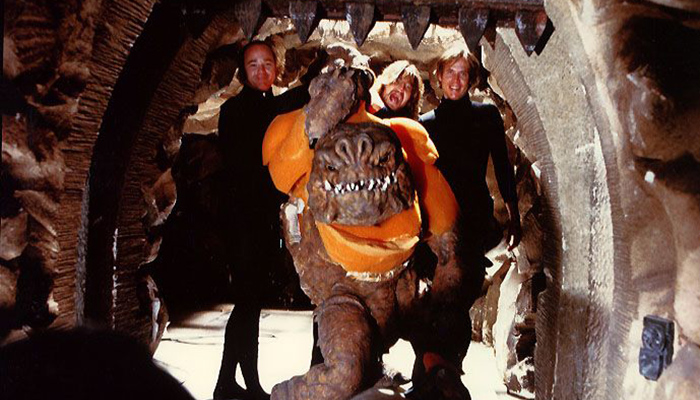 Kirk Thatcher (center, back row) posing with his fellow ILM creature performers in a rare shot of the human-size puppeted version of the Rancor monster seen in STAR WARS: RETURN OF THE JEDI.