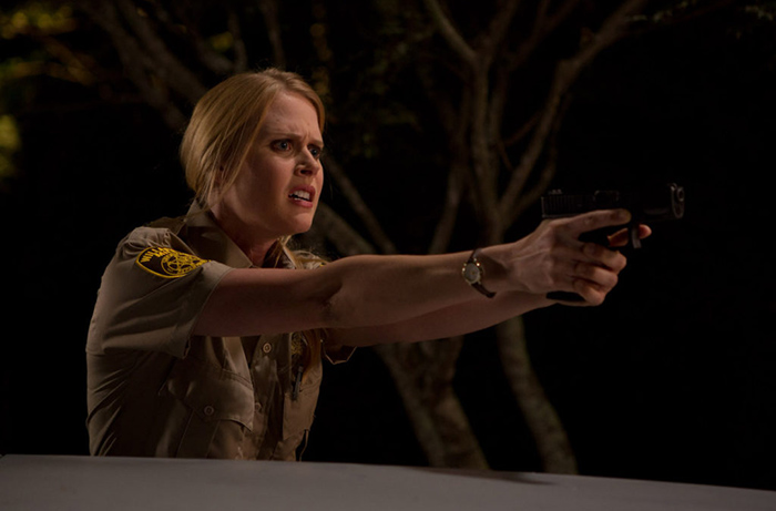 Janet Varney takes aim at another evil entity in Dana Gould's horror comedy series STAN AGAINST EVIL on IFC.