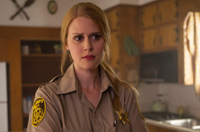 Janet Varney as Sheriff Evie Barret dealing with the curse of Willard's Mill in STAN AGAINST EVIL Season One. Season Two begins November 1st on IFC.