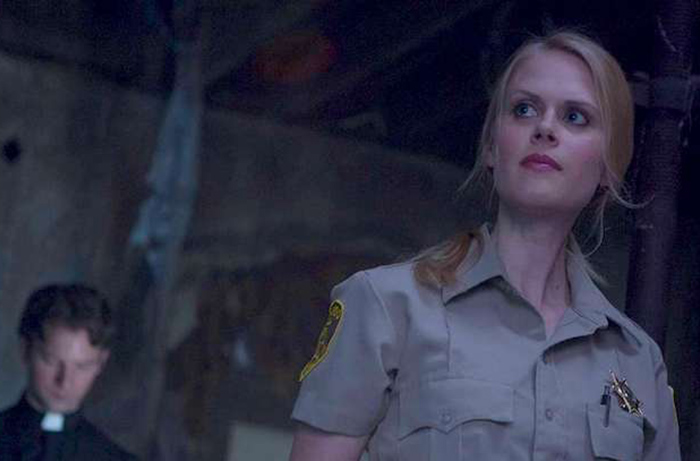 Janet Varney as Sheriff Evie Barret, about to encounter something bad in STAN AGAINST EVIL. Season Two begins November 1st on IFC.