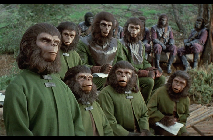Bobby Porter as Cornelius stands up for higher ape principles in a scene from BATTLE FOR THE PLANET OF THE APES.