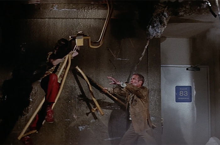 A tense scene from THE TOWERING INFERNO in which Bobby Porter doubled for Mike Lookinland in the harrowing stairwell climb.