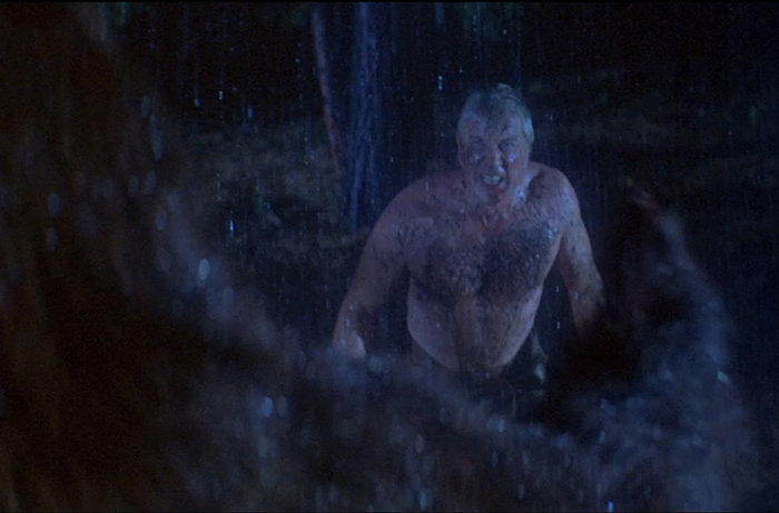 Bare-chested Leslie Nielsen battles a bear in DAY OF THE ANIMALS (1977).