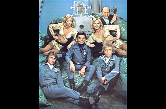 The cast of the 1977-78 sci-fi comedy series QUARK: (L to R) Tim Thomerson, Patricia Barnstable, Richard Benjamin, Bobby Porter (as Adam), Cyb Barnstable, Conrade Janis and Richard Kelton.