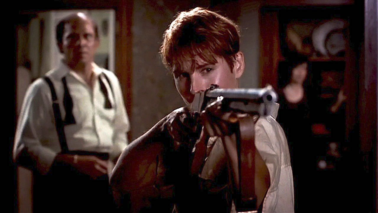 (L to R): Harry Cooper (Tom Towles) stands back while Barbara (Patricia Tallman) takes aim and kicks ass in Tom Savini's 1990 remake NIGHT OF THE LIVING DEAD.