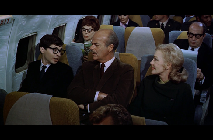 In a scene from the 1970 film AIRPORT, Lou Wagner as know-it-all Schuylet Shultz tries to explain to his parents that their plane is turning around.