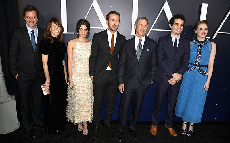 (L to R) Tom Everett Scott, Rosemarie DeWitt, Callie Hernandez, Ryan Gosling, Marc Platt, Damien Chazelle and Emma Stone appear at an event for LA LA LAND in 2016.