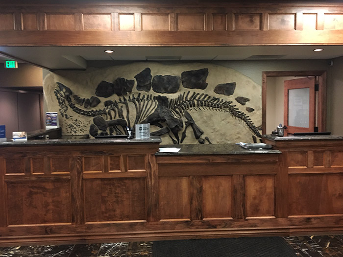 The reception desk in the Dino Hotel lobby in Lakewood, Colorado -- the fossil-filled home of the Revival League podcast.