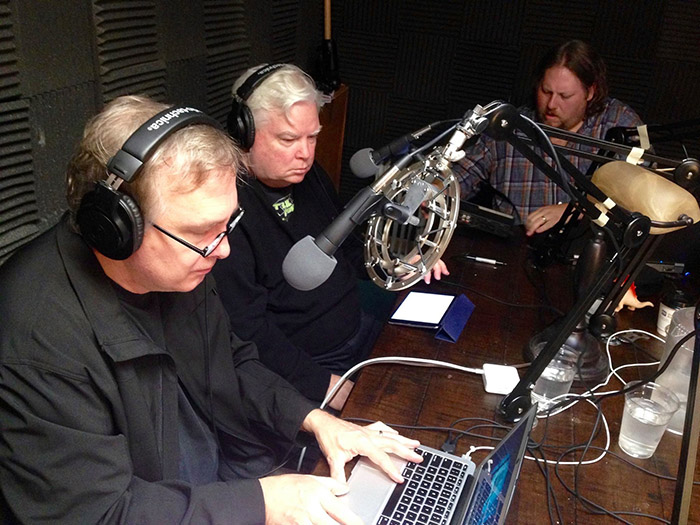 (L to R): MST alums Trace Beaulieu and Frank Conniff, with Ron McAdams record a MST3K Revival League radio play.