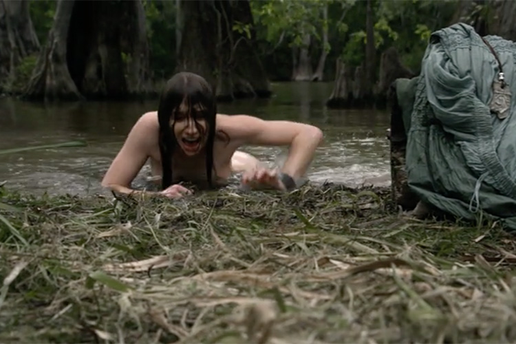 Jennifer Lynn Warren as Ophelia in a harrowing scene from the horror film CREATURE (2011).